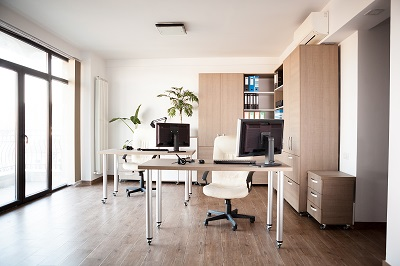 Interior of an empty modern office with an empty desk
